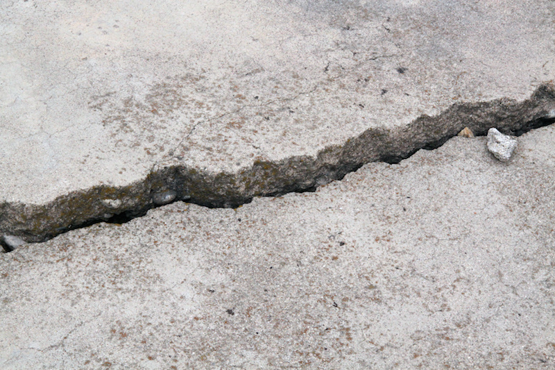Large crack in a sidewalk that could lead to injury from trip and fall accident