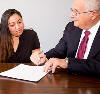 Personal injury attorney Reid Wissner consults with a client