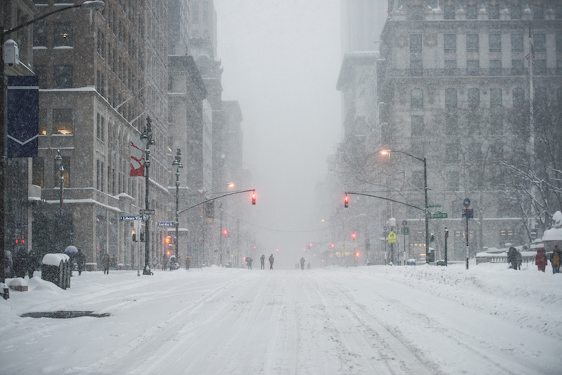 Snow and ice covering the roads in NYC, causing a danger of slip and fall accidents